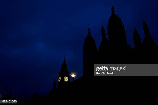 A light shines near Big Ben and The Houses of Parliament on May 7 2015 in London England The United Kingdom is going to the polls to vote today for a...
