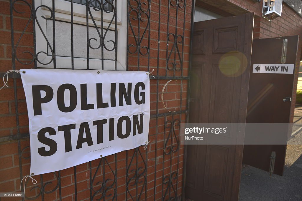 Light shining on a sign showing the electorate where the location of a polling station in Stockport, Greater Manchester, England, United Kingdom on Thursday 5th May 2016.