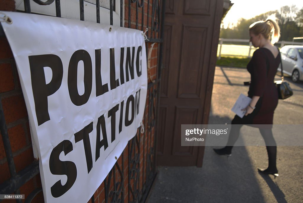 Light shining on a sign showing the electorate where the location of a polling station as a person enters the building in Stockport, Greater Manchester, England, United Kingdom on Thursday 5th May 2016.