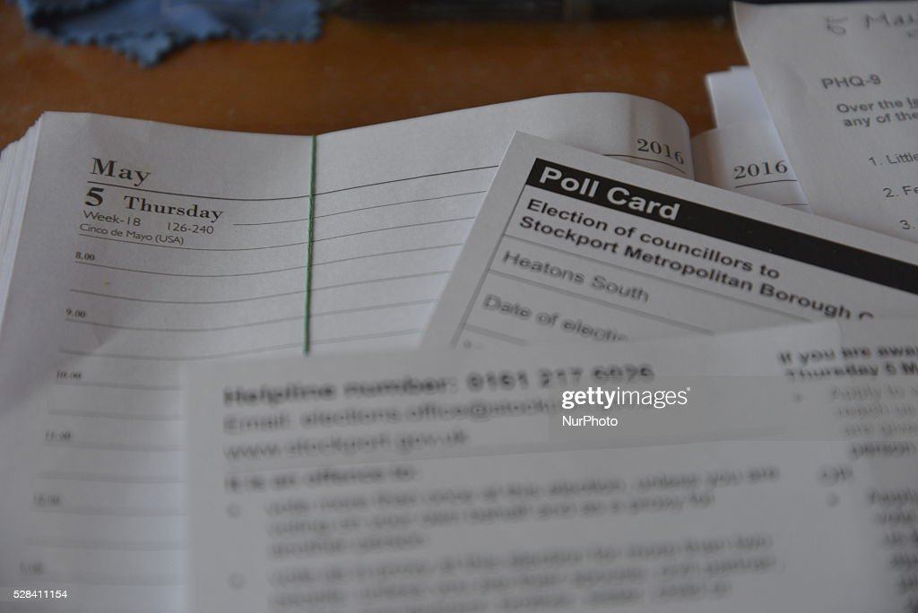 Light shining on polling card, on top of a diary open at the day and date of the election, in Stockport, Greater Manchester, England, United Kingdom on Thursday 5th May 2016.