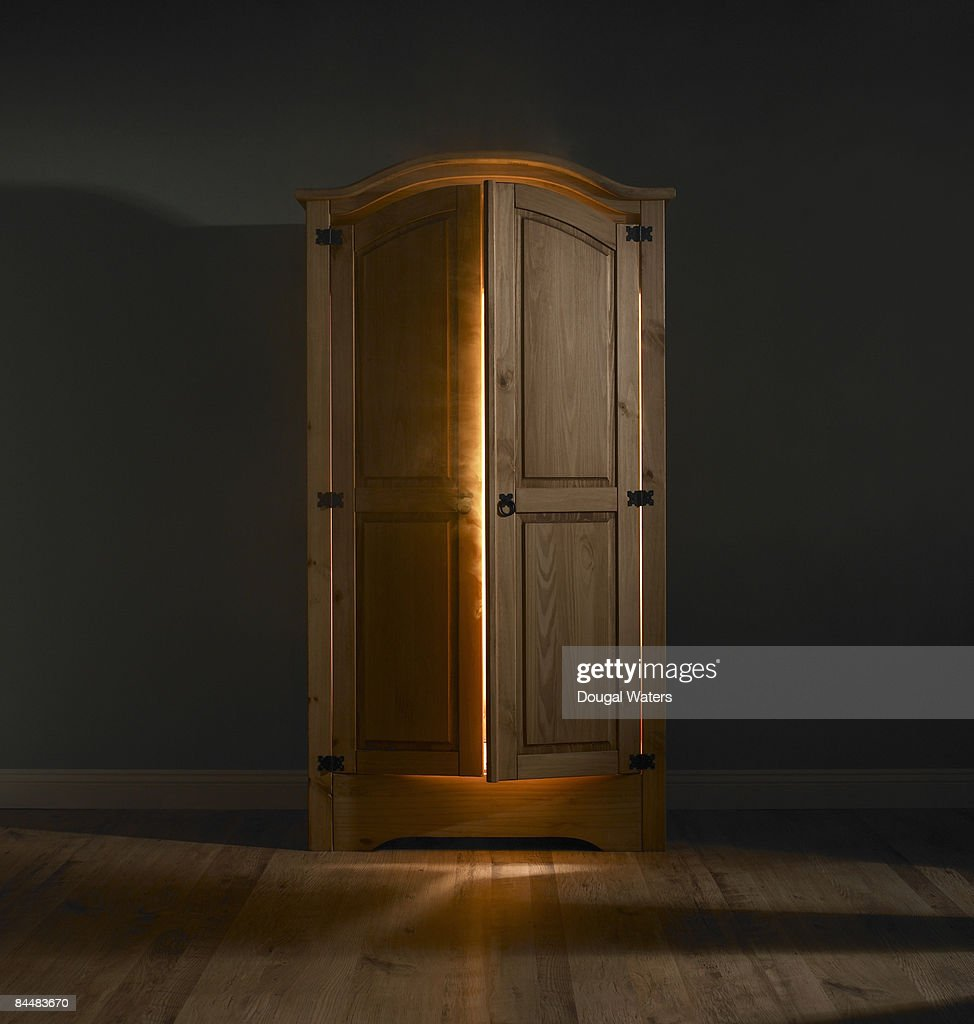 Light shining out of wardrobe door.