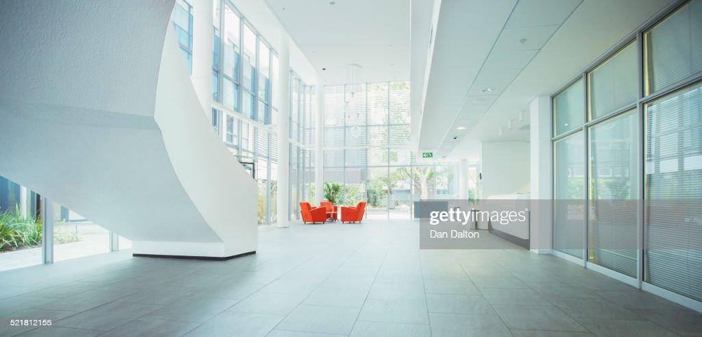 Light shining through windows in office building : Stock Photo
