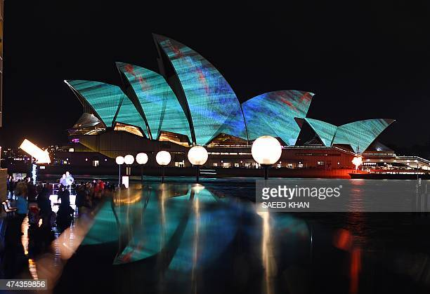 A light show called 'Vivid' changes the appearance of the Sydney Opera House in Sydney on May 22 2015 Vivid Sydney an annual festival of light music...