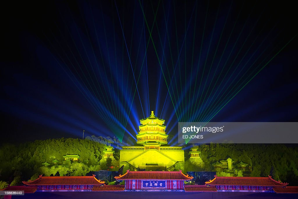 A light show illuminates the Summer Palace during a count-down event for the new year in Beijing on December 31, 2012. AFP PHOTO / Ed Jones