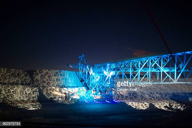 A light show iluminates the CottbusNord openpit lignite coal mine during an event to mark the mine's closure on December 23 2015 near Cottbus Germany...