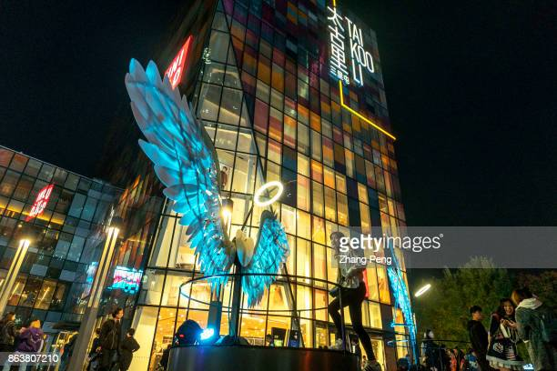 A light show of angel wings on the square of Sanlitun business district which is the fashion landmark of Beijing