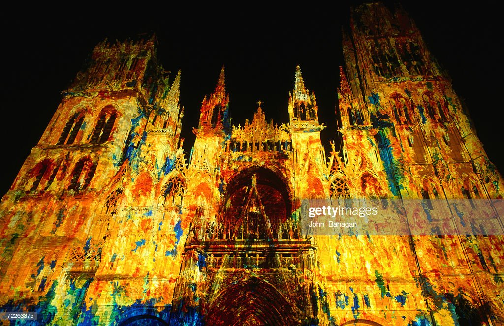Light show projected on Rouen Cathedral, Rouen, France : Stock Photo
