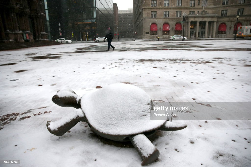 Light snow begins to fall in Copley Square in Boston as a winter storm arrives in the region on Mar. 14, 2017.