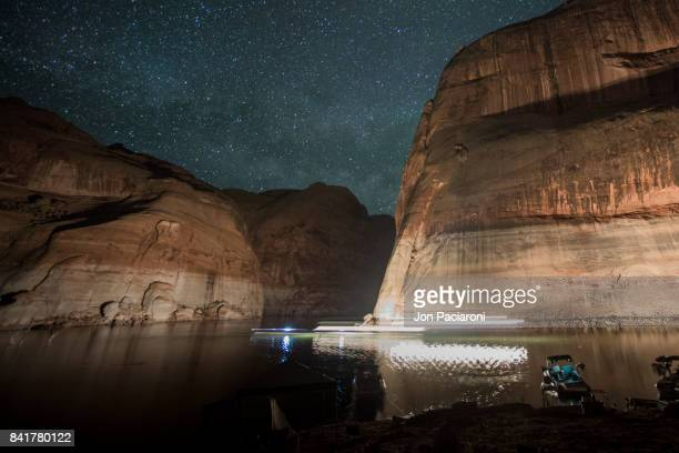 Light streaks of boat passing by at night through Escalante Canyon in Lake Powell