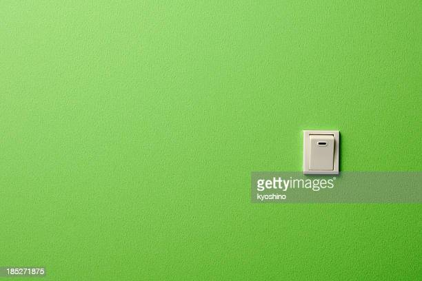 ON OFF light switch on green wall with copy space