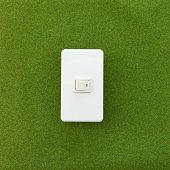 A light switch on the grass.