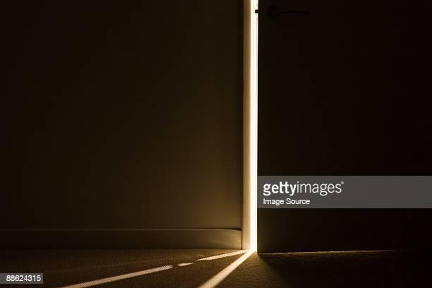 Light through the gap of an open door