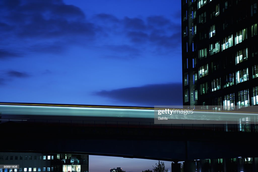 Light trail of train on bridge at night : Stock Photo
