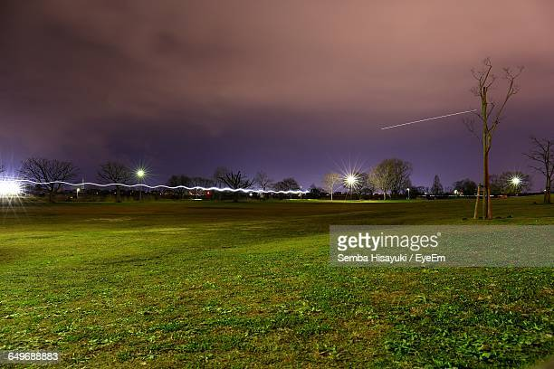 Light Trail On Grassy Field At Park Against Sky