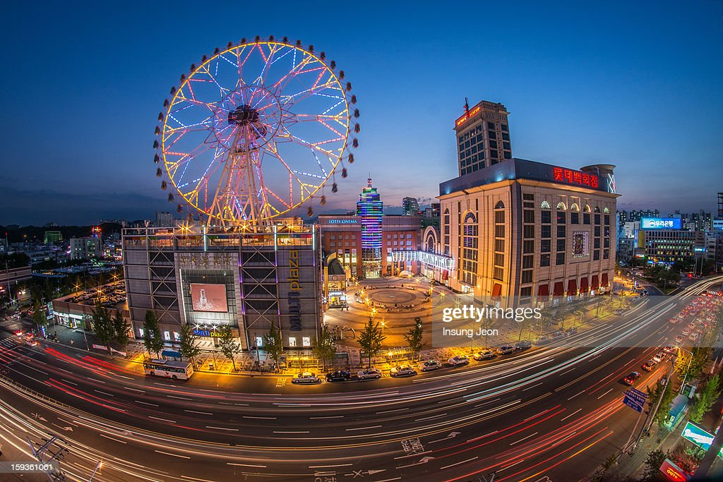 CONTENT] Light trails and Ferris wheel at night in , South Korea, Fisheye shot