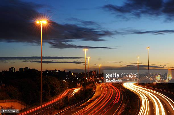 Light trails coming and going on a motorway during rush hour