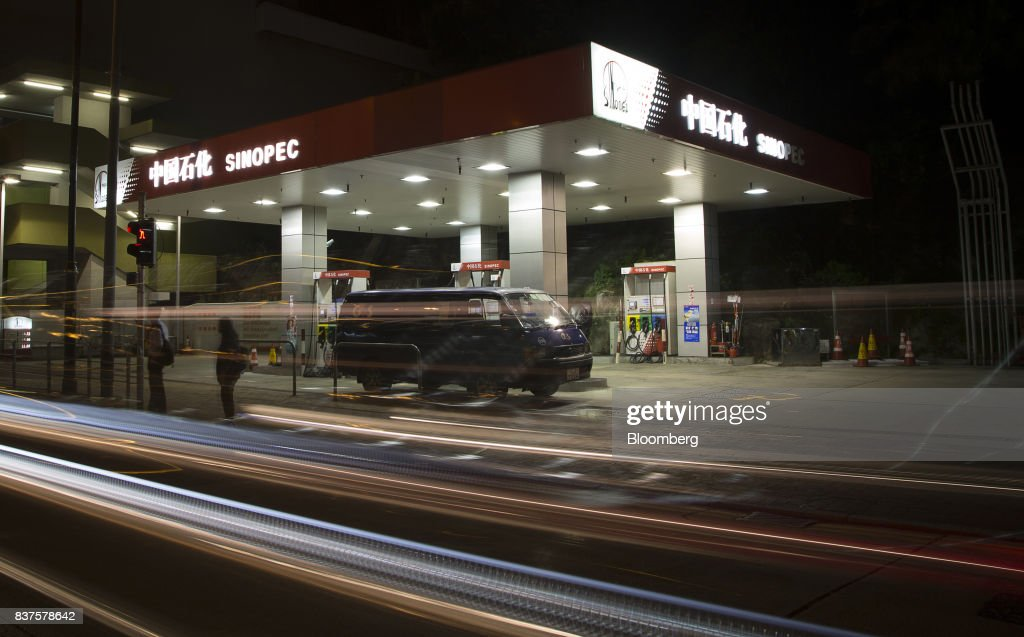 Light trails from passing traffic are seen in front of at a China Petroleum & Chemical Corp. (Sinopec) gas station at night in Hong Kong, China, on Tuesday, Aug. 22, 2017. Sinopec is scheduled to report second-quarter results on Aug. 25. Photographer: Vivek Prakash/Bloomberg via Getty Images