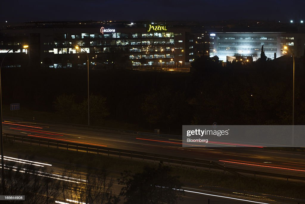 Light trails from passing traffic are seen near the illuminated offices of Jazztel Plc in Alcobendas, Spain, on Thursday, April 4, 2013. Jazztel almost doubled its share of the Spanish broadband market from 2009 to 2012 as it focused mostly on the fixed-telephone business through a reliable and affordable product that has gained popularity among debt-strapped Spaniards. Photographer: Angel Navarrete/Bloomberg via Getty Images