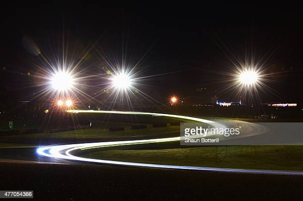 Light trails from the cars during the Le Mans 24 Hour race at the Circuit de la Sarthe on June 13 2015 in Le Mans France