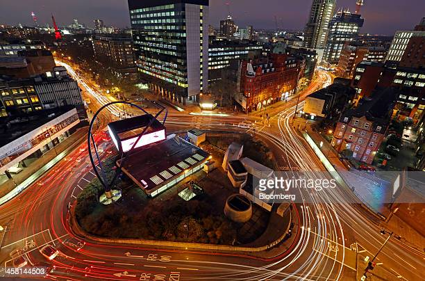 Light trails from traffic are seen as they pass around the Old Street roundabout in the area known as London's Tech City in London UK on Tuesday Dec...