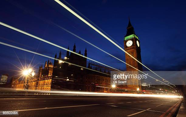 Light trails from vehicles passing in front of the Houses of Parliament are seen on November 27 2009 in London England In a speech to the House of...