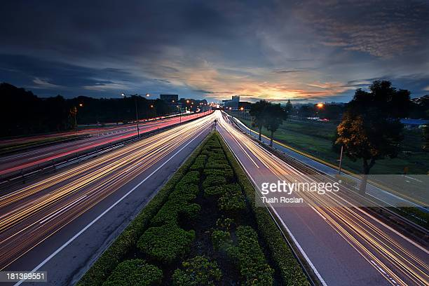 Light Trails in busy highway at sunrise