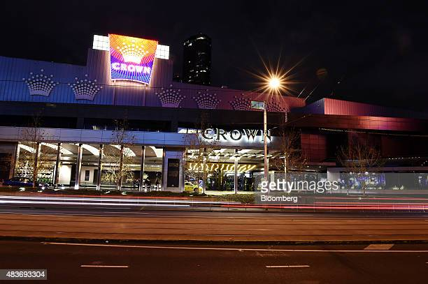 Light trails left by passing vehicles move past Crown Resorts Ltd's Crown Melbourne casino and entertainment complex at night in Melbourne Australia...