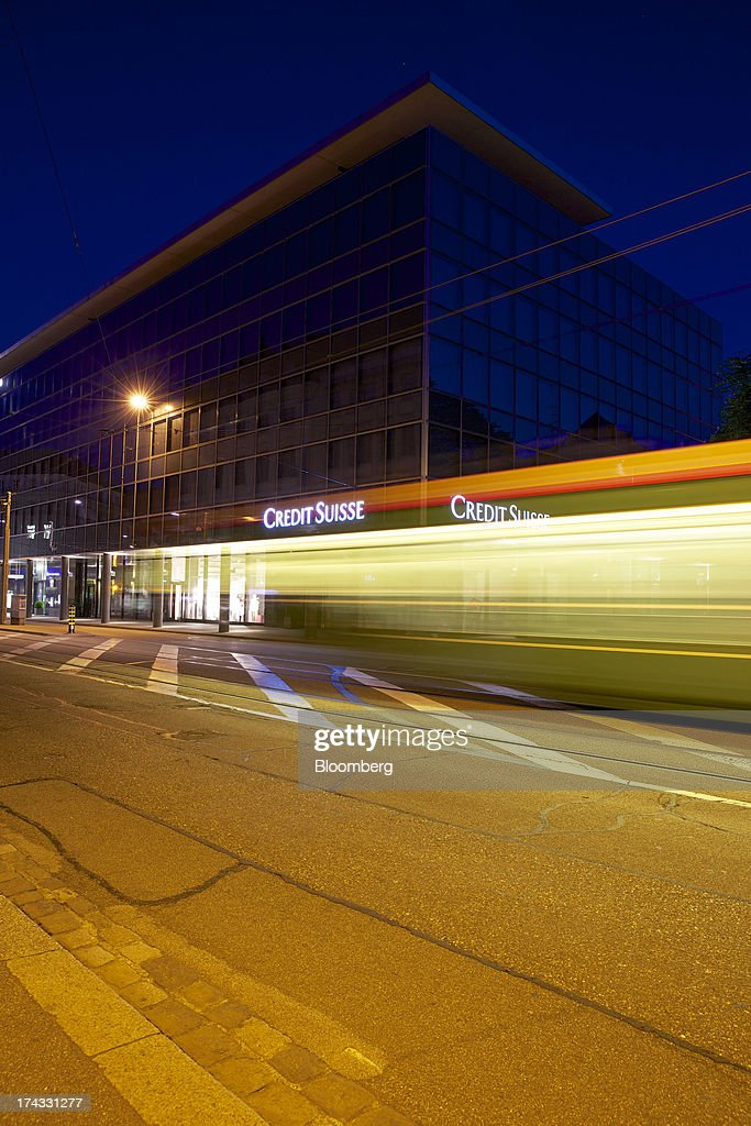 Light trails made by a passing tram are seen in front of a branch of Credit Suisse Group AG in Basel, Switzerland, on Tuesday, July 23, 2013. Europe's biggest banks, which more than doubled their highest-quality capital to $1 trillion since 2007 to meet tougher rules, may have further to go as regulators scrutinize how lenders judge the riskiness of their assets. Photographer: Gianluca Colla/Bloomberg via Getty Images