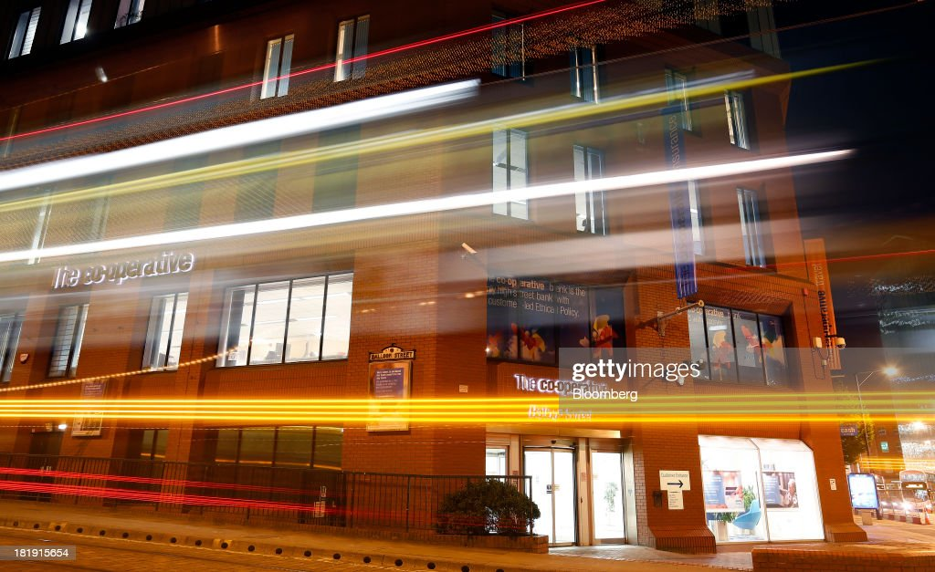 Light trails made by a passing tram are seen outside a Co-Operative Bank Plc branch, a unit of Co-Operative Group Ltd., at night in Manchester, U.K., on Tuesday, Sept. 24, 2013. The parent of Co-operative Bank, which is seeking capital after losses, may avoid being forced to rescue the lender thanks to an accord it struck with regulators last year, according to bondholders. Photographer: Paul Thomas/Bloomberg via Getty Images