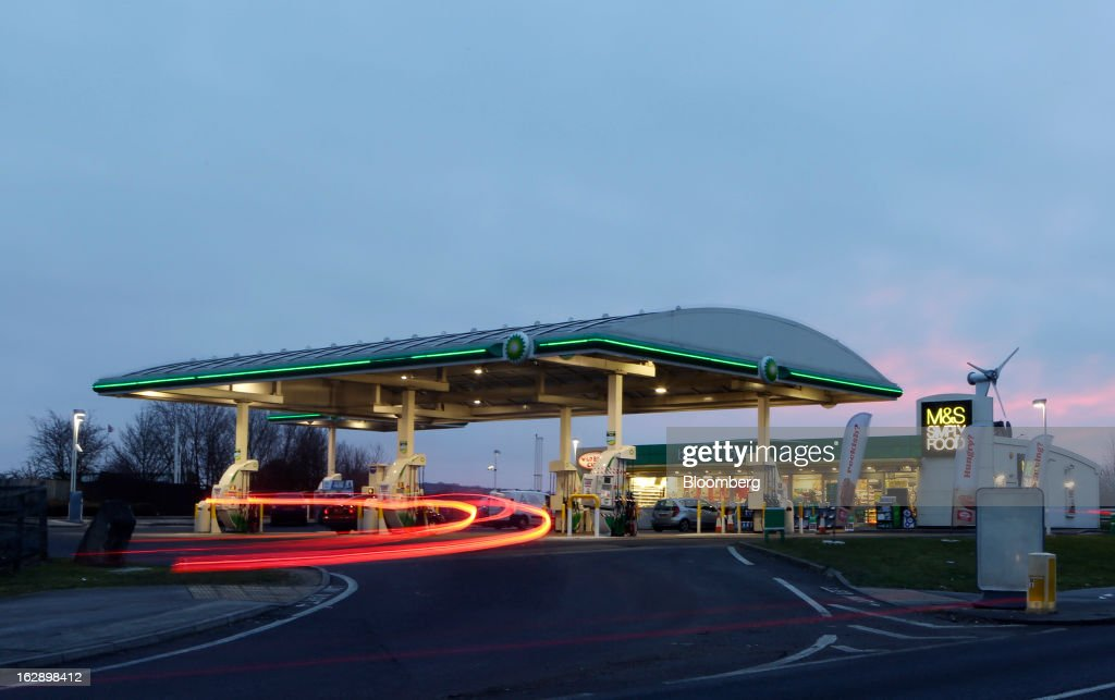 Light trails made by a vehicle are seen entering a BP gas station, operated by BP Plc, in Upminster, U.K., on Thursday, Feb. 28, 2013. BP Plc's push to maximize profits and cut costs at the Macondo well was a 'root cause' of the explosion that led to the 2010 Gulf of Mexico oil spill, a safety expert who studied the disaster said. Photographer: Chris Ratcliffe/Bloomberg via Getty Images