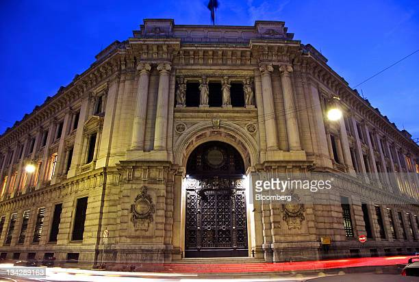 Light trails made by passing automobiles are seen in front of the Banca d'Italia Italy's central bank in Milan Italy on Tuesday Nov 29 2011 Italian...