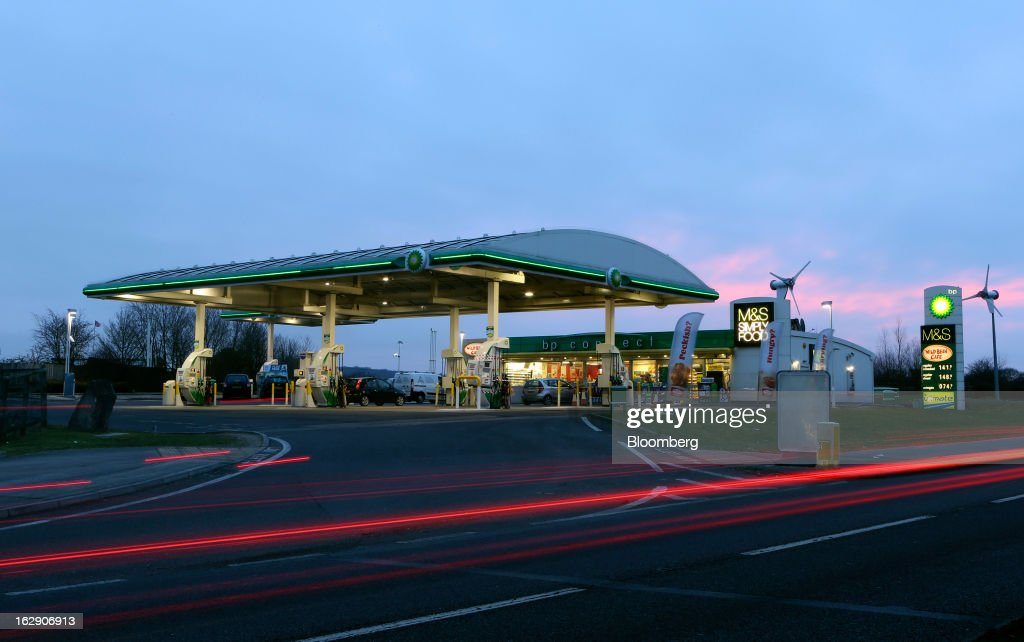 Light trails made by passing vehicles are seen in front of a BP gas station, operated by BP Plc, in Upminster, U.K., on Thursday, Feb. 28, 2013. BP Plc's push to maximize profits and cut costs at the Macondo well was a 'root cause' of the explosion that led to the 2010 Gulf of Mexico oil spill, a safety expert who studied the disaster said. Photographer: Chris Ratcliffe/Bloomberg via Getty Images