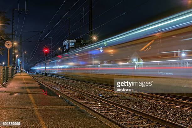 Light trails of a train going through station, Germany