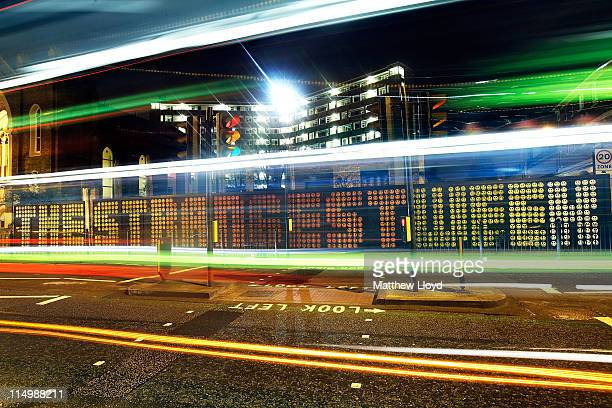 Light trails of vehicles in a long exposure pass a street mural by the artist Ben Eine in the East End on March 10 2011 in London England The East...