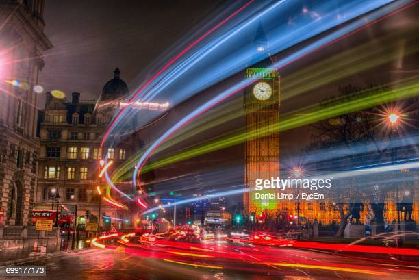 Light Trails On Road Against Big Ben In City At Night