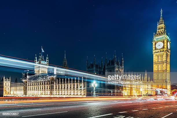 Light Trails On Road Against Houses Of Parliament And Big Ben