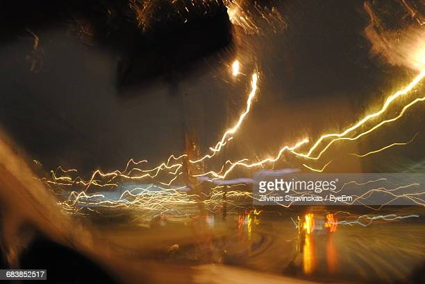 Light Trails On Street Seen Through Car Windshield