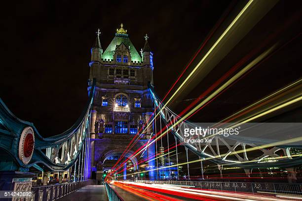 Light trails on Tower Bridge at night, London