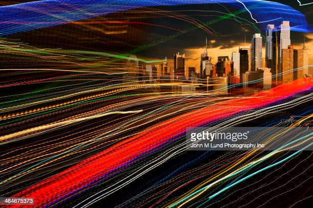 Light trails speeding toward city