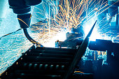The Light Welding robots movement in a car factory, manufacturing, industry, factory