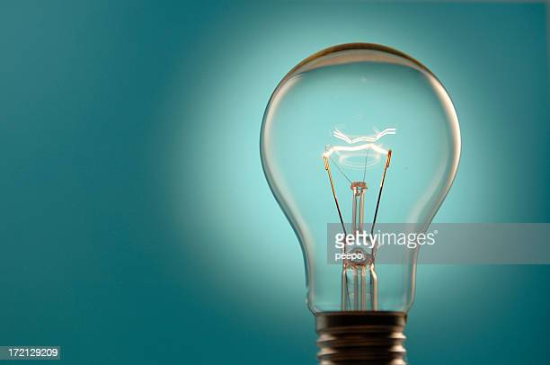 Lightbulb Against Blue Background