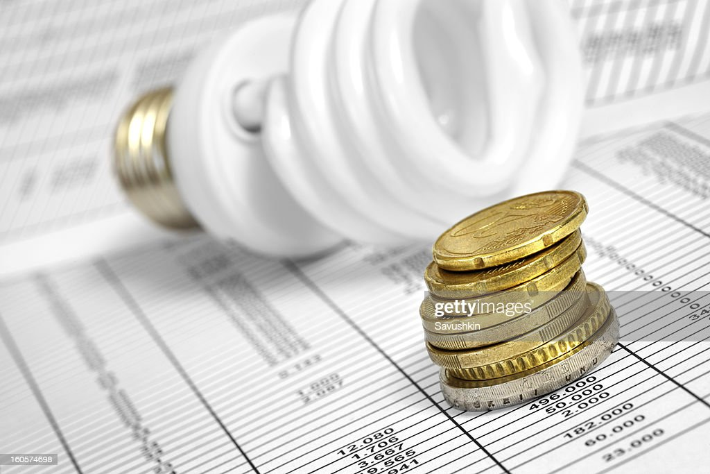 Lightbulb  and Coin Stack. : Stock Photo