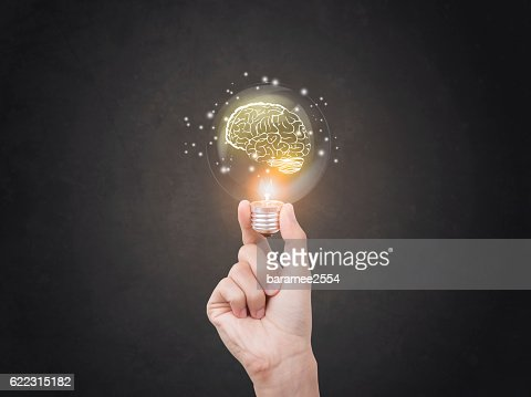 lightbulb brainstorming creative idea abstract icon on business hand. : Foto de stock