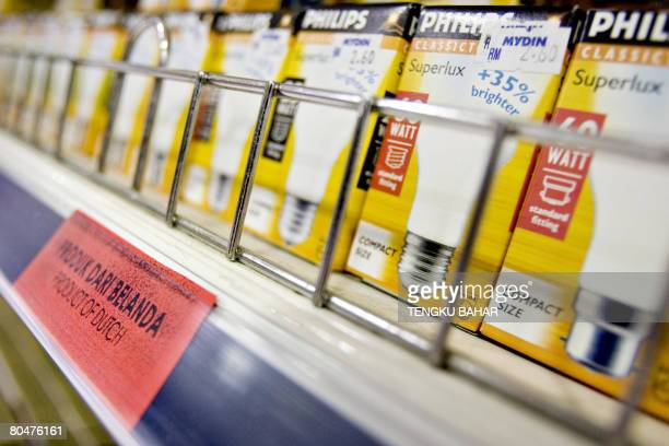 Lightbulbs produced by Netherlandsbased electronics company Philips go on sale next to a red tag identifying them as a Dutch product at a Muslimowned...