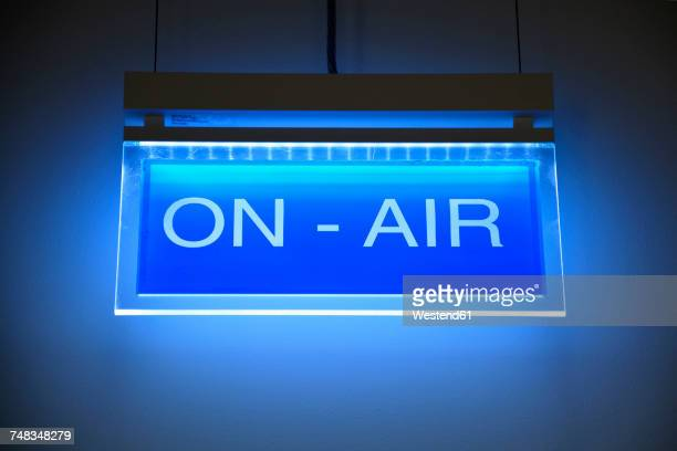 Lighted blue sign on air