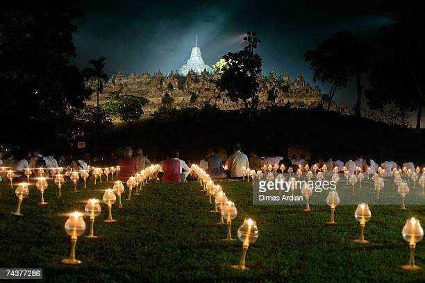 Lighted candles are seen at the yard of Borobudur temple built between 750 and 842 AD June 1 2007 in Magelang Central Java province Indonesia...
