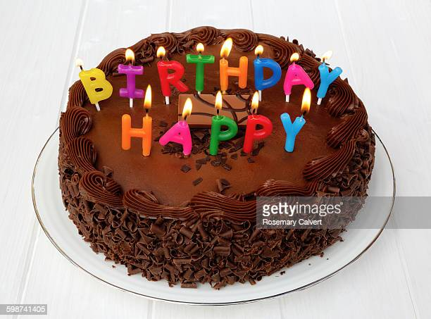 Lighted candles on chocolate birthday cake