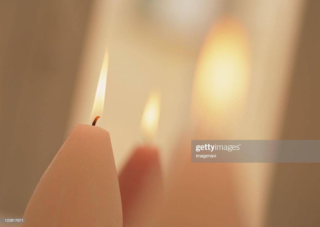 Lighted candles : Stock Photo