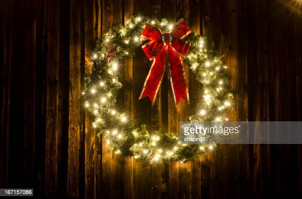 Lighted Christmas Wreath on Old Barn