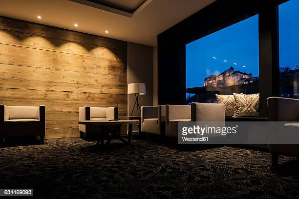 Lighted hotel lobby with view to the castle